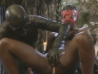 Lustful african babe is having latex fun with two horny dudes nailing her ass