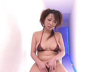 Teen in bikini oils up her hairy pussy