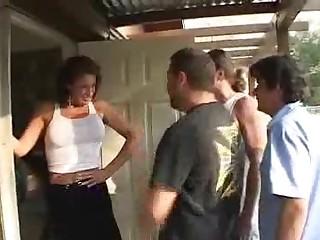 Redhead MILF Sucking Off Two Guys