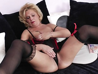 Horny blonde mature slut grinding on the couch